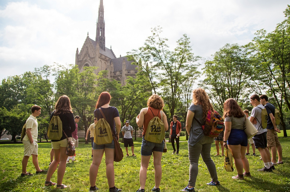 Students standing together in a circle by Heinz Chapel